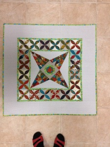 Baby quilt using centre of Jen Kingwell's Midnight at the Oasis pattern.